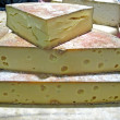 Seasoned cheese from cows ' milk for sale to the market - Foto de Stock