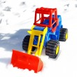 Child's toy scraper in use on fresh snow — Stock Photo
