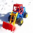 Child's toy scraper in use on fresh snow white — Stock Photo
