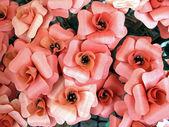 Pink wooden flowers handmade in retail market — Stock Photo