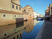 Reflections of the medieval church in the Canal in Chioggia — Stock Photo