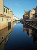 Boats and ships moored along the Canal in Chioggia — Stock Photo