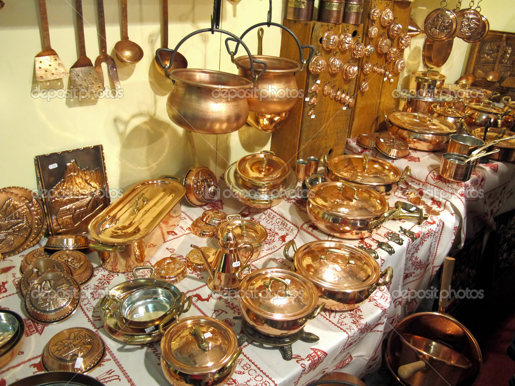 Pots and pans gleaming copper for sale at the market ...