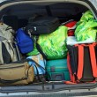 Very car with the trunk full of luggage ready for the departure - Stock Photo