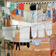 Street in venice with washing hung out to dry in the sun — Stock Photo