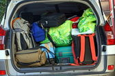 Very car with the trunk full of luggage ready for the departure — Stock Photo