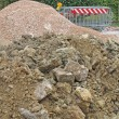 Stock Photo: Piles of land and stones mined by excavation in site