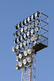Towers with spotlights and floodlights to illuminate the games at the stadium — Stock Photo