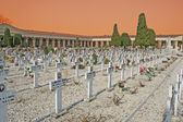 Headstones and crucifixes of a cemetery in Italy — Stock Photo