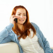 Young woman talking at mobile phone — Stock Photo