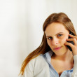 Beautiful businesswoman talking on the mobile phone — Stock Photo