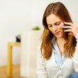 Charming woman speaking on the phone at home — Stock Photo