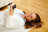 Happy woman making a call on the mobile phone — Stock Photo