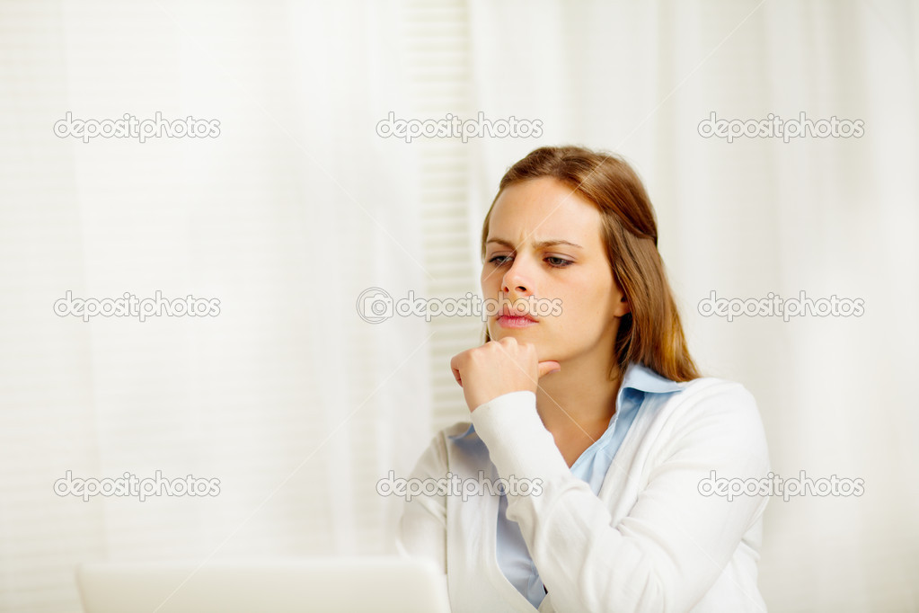 Portrait of a beautiful young female thinking in from laptop — Stock Photo #10218877