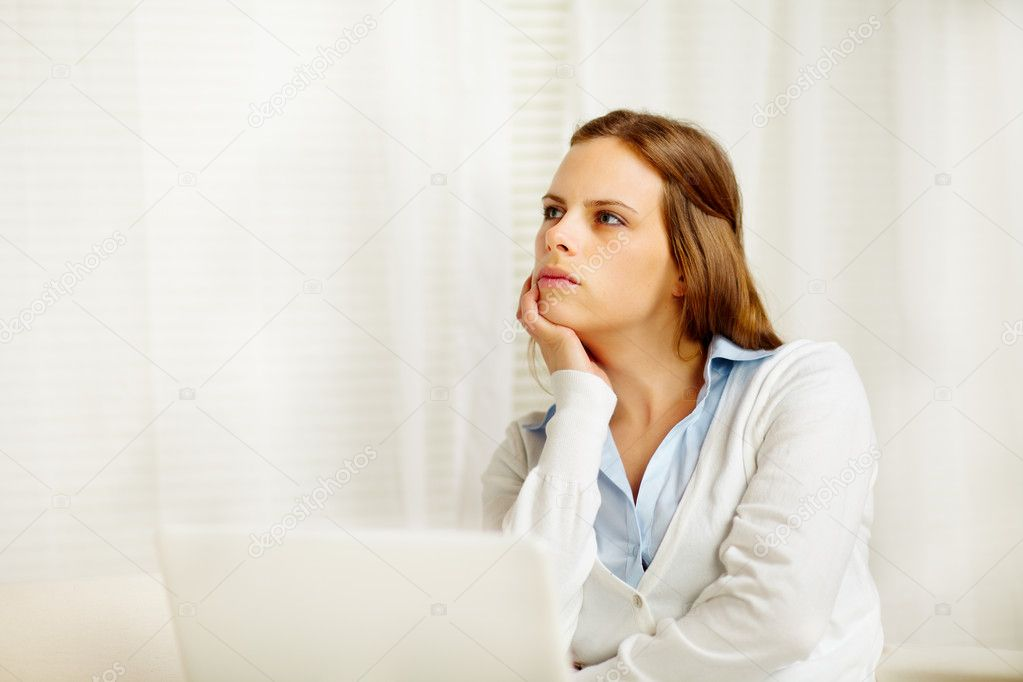 Portrait of a beautiful caucasian girl thinking in from laptop — Stock Photo #10218883