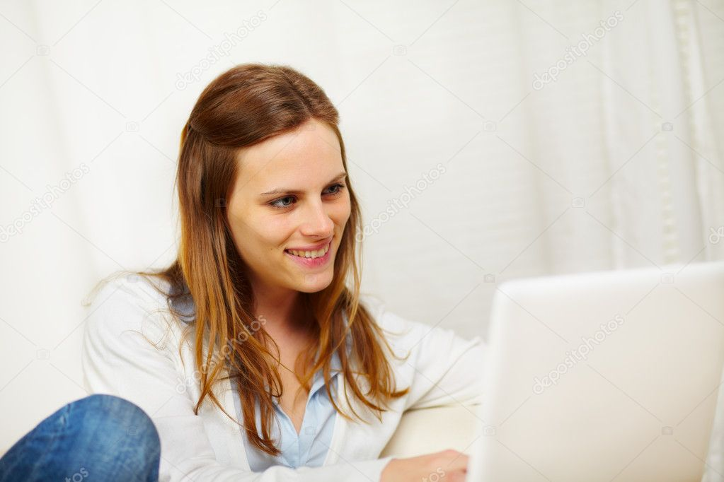 Close up portrait of a young caucasian woman working on laptop — Stock Photo #10218971