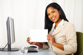 Executive woman showing a white card — Stock Photo