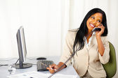 Happy executive talking on phone — Stock Photo