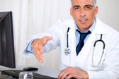 Senior trustworthy doctor greeting — Stock Photo