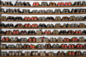 Bowling shoes on rack — Stock Photo