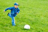 Child playing football — Stock Photo