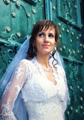 Bride at old door — Stock Photo