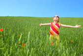 Girl stay at green field — Stock Photo