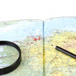 Magnifying Glass and pencil on the map — Stock Photo