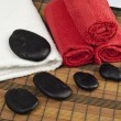 Black stones with towels SPA focused on towels — ストック写真