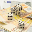 Five dices on money — Stock Photo