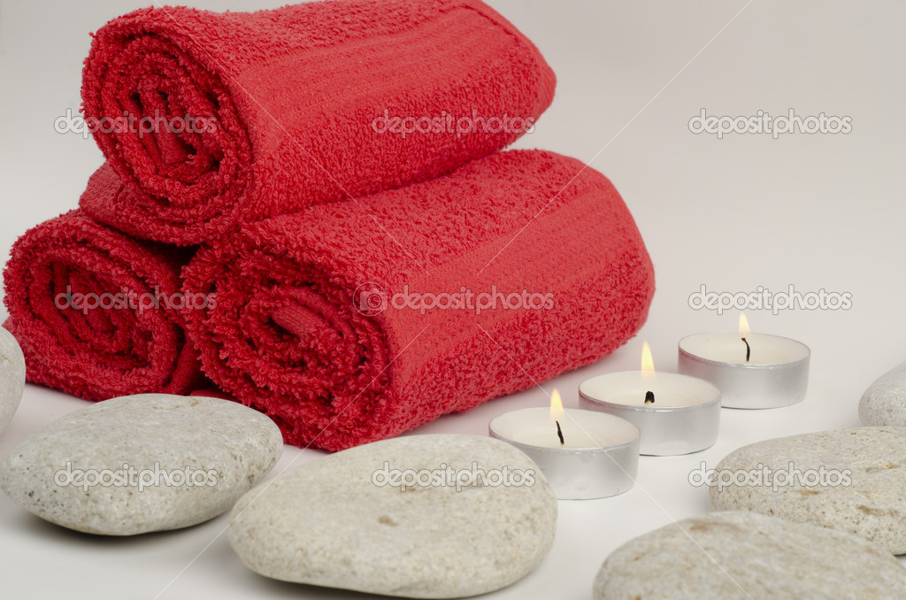 Image of red towels with stones and candles  Stock Photo #9704299