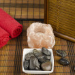 Spa concept with stones, salt and towels — Stock Photo