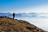 Misty mountain hills and silhouette of a man — Stock Photo
