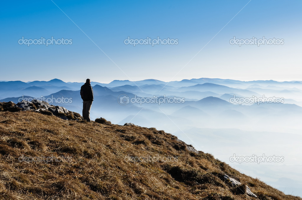 Misty mountain hills and silhouette of a man — Stock Photo #10719352