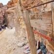 The Siq sign and entrance, the narrow slot-canyon, the entrance passage to — Stock Photo