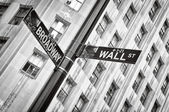 Wall street and Broadway street sign black and white, New York — Stock Photo