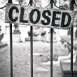 Stock Photo: Closed sign on metal doors