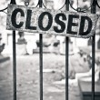 Closed sign on metal doors - Stock Photo