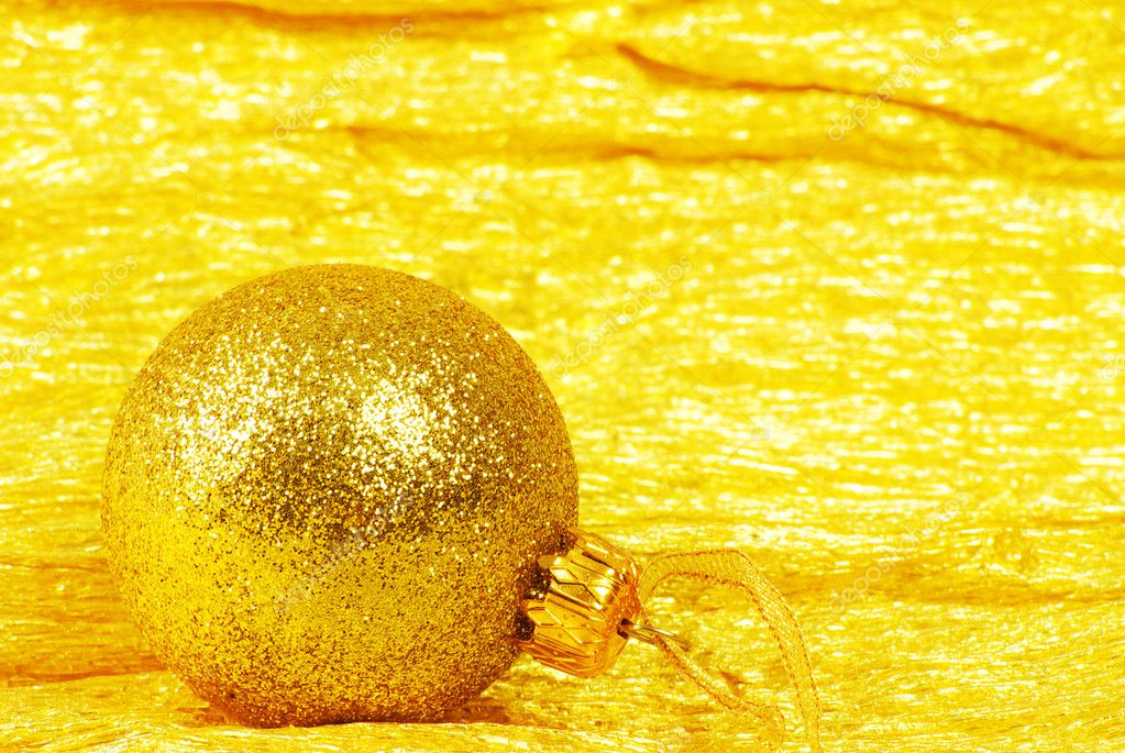 Christmas ball on golden background — Stock Photo #10260382