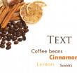 Coffee beans, cinnamon, lemon and sweets - Stock Photo