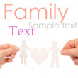 Royalty-Free Stock Photo: Paper family in hands isolated on a white background