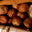 Coffee beans, cinnamon and nuts - Stock Photo