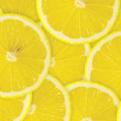 Royalty-Free Stock Photo: Abstract background with citrus-fruit of lemon slices. Close-up.