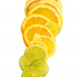 Royalty-Free Stock Photo: Vitamin C Overload, Stacks of sliced fruit isolated on white