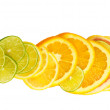 Vitamin C Overload, Stacks of sliced fruit isolated on white - Stock Photo