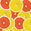 Abstract background of citrus slices. Closeup. Studio photograph - Stockfoto