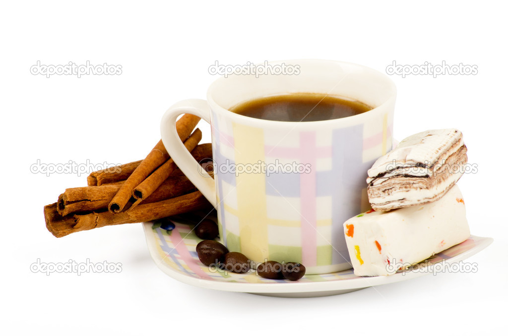 Coffee cup with sweets an cinnamon on white background  Stock Photo #9358317