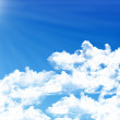 Royalty-Free Stock Photo: Blue sky background with tiny clouds
