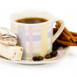 Coffee cup with sweets an cinnamon on white background - Stock Photo