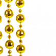 Background made of a brilliant celebratory beads of golden color - Zdjęcie stockowe
